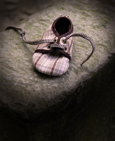 Loneliness -shoe on stone