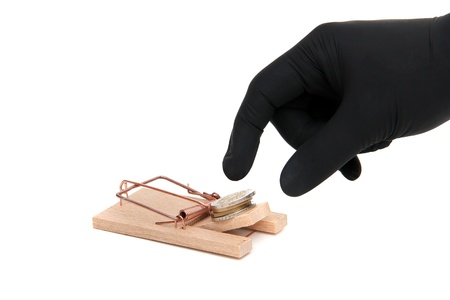 deprivation: loose cash on mousetrap Stock Photo