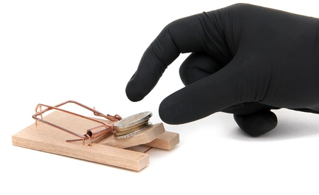 loose cash on mousetrap Stock Photo - 12291252