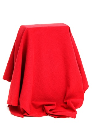 is covered: mysterious box coverd with red drapery Stock Photo