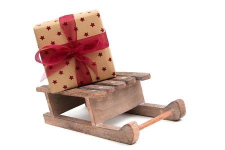 endow: christmas gift on wooden sledge