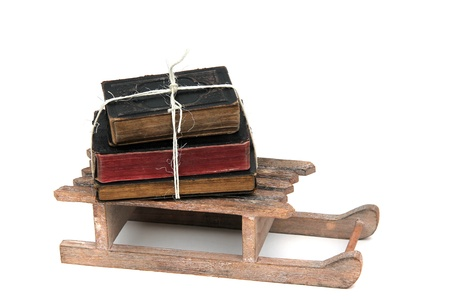 stack of books on sledge