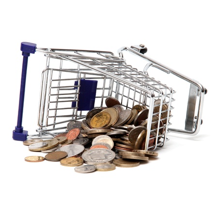 Toppled basket of commodities with coins