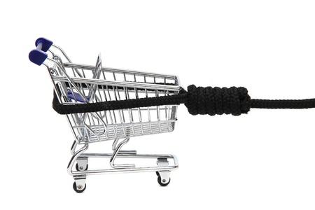 shoppingcart: shopping addiction - shoppingcart on gibbet Stock Photo
