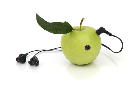 download music: green apple with headphones on white