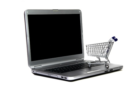 laptop and basket of commodities on white Stock Photo - 12291283