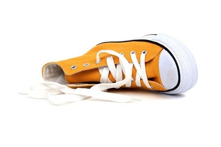 yellow sneaker with white latchet on white Stock Photo - 12291277