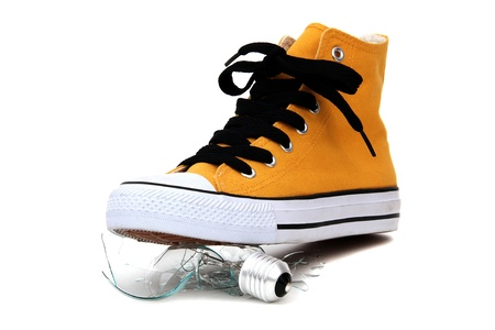 broken bulb under sneaker Stock Photo - 12291311