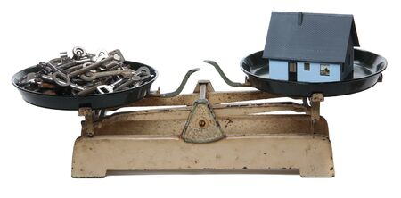 clues: keys and home on old scales Stock Photo
