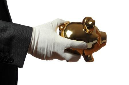 gant blanc: Butler avec gant blanc une tirelire d'or Banque d'images