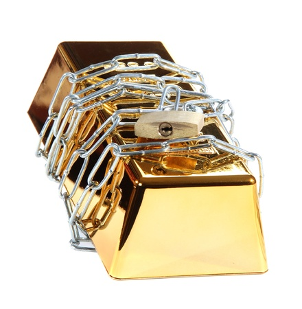 gold bar protected with chain and padlock photo