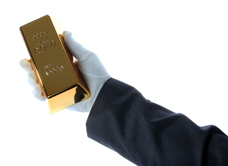 gold bar in hand of a business man