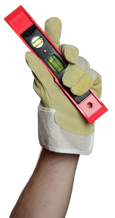 handyman with work glove holding a level photo
