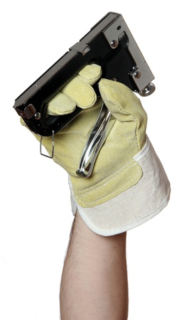 handyman with work glove holding a staple gun photo