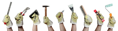 home repair: concept of tools in hands with gloves Stock Photo