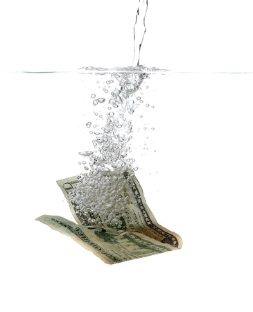 laundering: Dollar banknote in water and bubbles Stock Photo