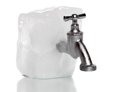 frozen water-tap on ice rock Stock Photo