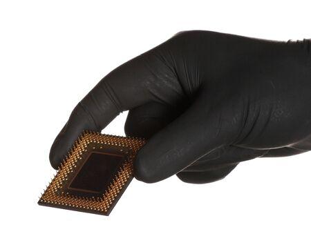 black gloves holding microprocessor