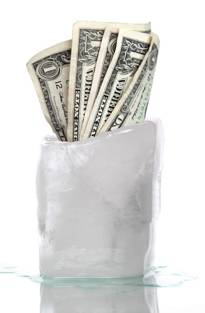 ice with frozen dollar banknotes