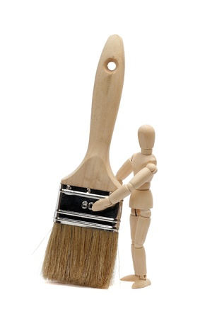 paintbrush and wooden doll Stock Photo - 15482740