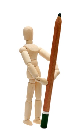 wooden doll with pencil Stock Photo - 15482749