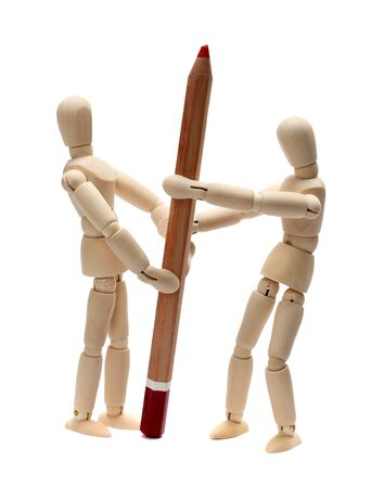 wooden doll fighting about red pencil Stock Photo - 15482762