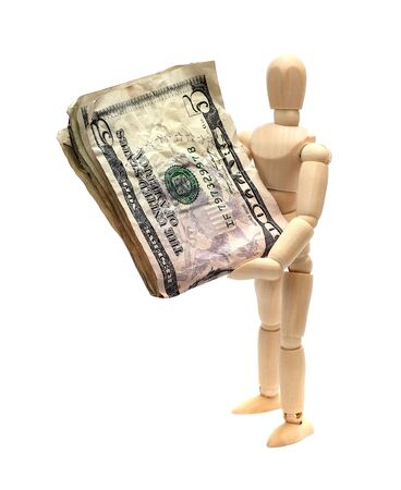 wooden doll with dollars photo