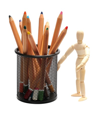 wooden doll with pencils in garbion cage photo