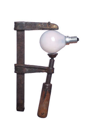 under pressure: bulb under pressure in old clamp Stock Photo
