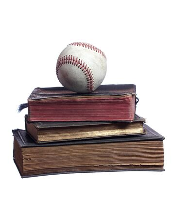 old baseball on old books photo
