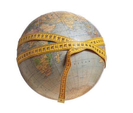 globe with yellow measure tape Stock Photo