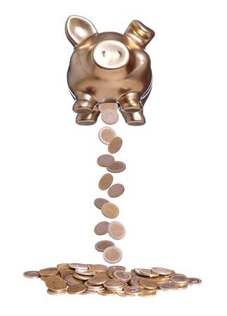coins falling out of golden piggybank