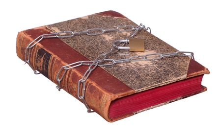 old book protected with chain and padlock photo