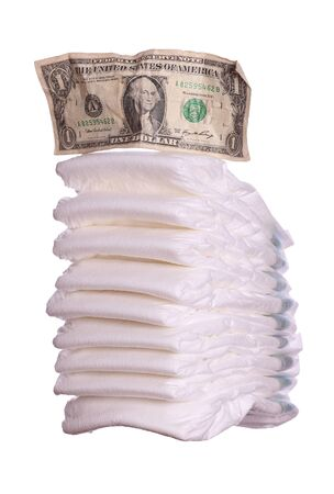 stack of diaper with dollar note Stock Photo - 17929362