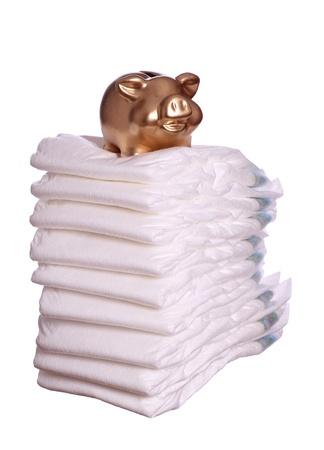 stack of diaper with golden piggybank Stock Photo - 17929296