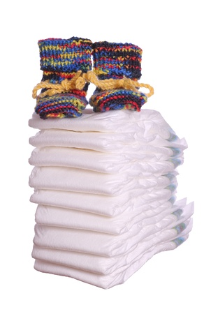 woll: stack of diaper with baby shoes