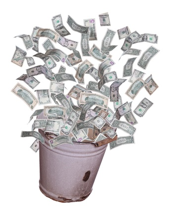 dollars flying out of old bucket Stock Photo