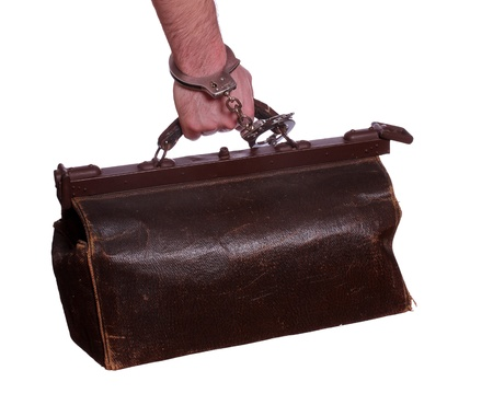 old leather bag with handcuff photo