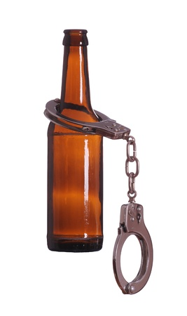 bottle with handcuff Stock Photo - 18248639