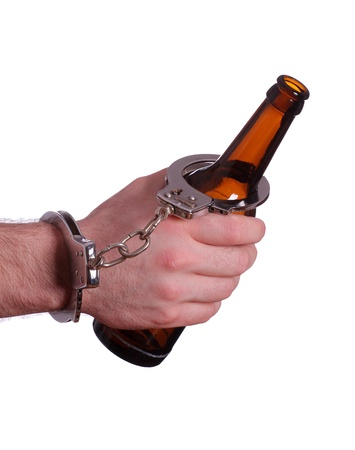 alcoholism with handcuff and bottle Stock Photo