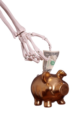 skeleton hand with dollar and piggybank photo