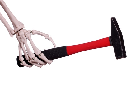 human skeleton: skeleton hand with hammer Stock Photo
