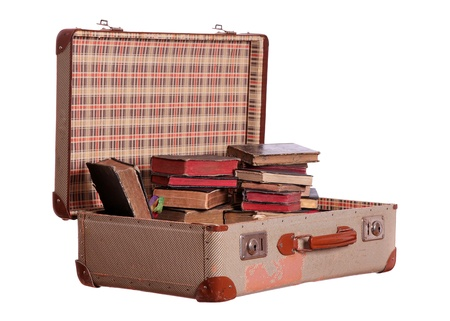 old suitcase stuffed with old books photo