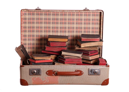 suitcase stuffed with books photo