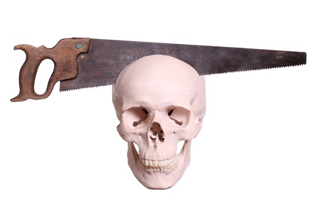 old saw cutting in skull photo