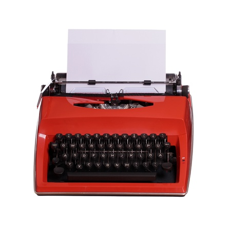 red typewriter with white paper photo