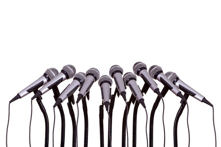 news stand: press conference with microphones
