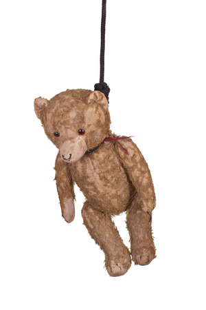 old teddy bear hanging on gibbet photo