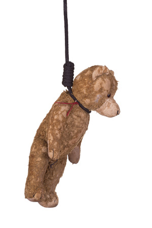 gibbet: old teddy bear hanging on gibbet Stock Photo