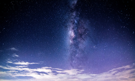 vertical milky way and starry field on clear sky with minimal cloud .